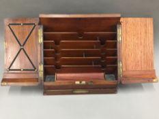 A Victorian walnut stationery box