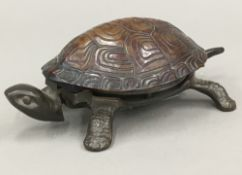 A novelty tortoise form desk bell - WITHDRAWN