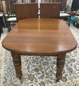 A Victorian two leaf oak extending dining table