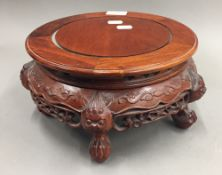 A Chinese carved hardwood stand