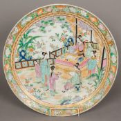 A large Chinese porcelain charger, well painted with a scholarly figure,