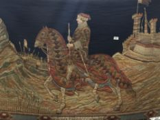 A tapestry wall hanging depicting a soldier on horse back