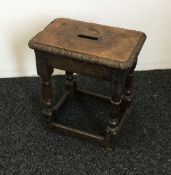 A carved oak joint stool