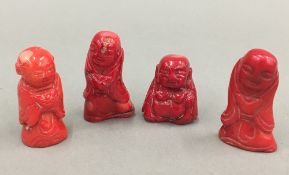 Four coral Buddhas