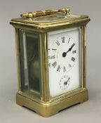 A late 19th/early 20th century brass cased carriage alarm clock