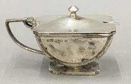 A silver mustard pot