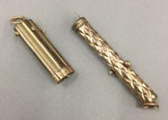 A gilt metal multi-tool retracting etui,