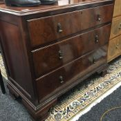 A 20th century walnut chest of drawers