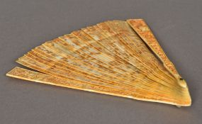 A 19th century Chinese carved ivory fan, intricately worked with various figures and animals.