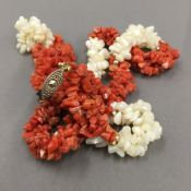 A white and red coral necklace (62 grammes total weight)