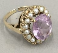 A 9 ct gold amethyst and seed pearl ring (5.