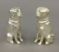 A pair of dog formed salt and peppers