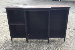 An Edwardian mahogany open break front dwarf bookcase
