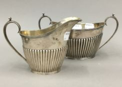 A silver sugar bowl and cream jug