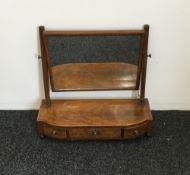 A 19th century three drawer mahogany toilet mirror