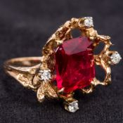 A contemporary unmarked gold, diamond and red stone ring,