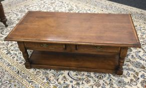 A modern two drawer oak coffee table