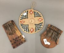 Two African instruments and an African art hanging