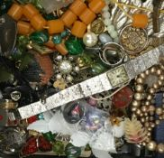 A tin of costume jewellery