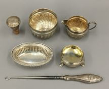 A small quantity of small silver items, including a cream jug and sugar bowl, a salt, etc.