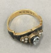 An 18 ct gold and enamel mourning ring (3.