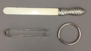 A silver handled letter opener,