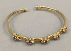 A 9 ct gold amethyst and diamond bangle (8.