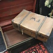 A painted tin trunk,
