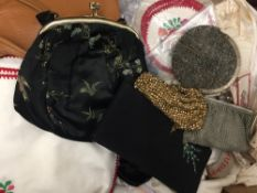 A quantity of vintage handbags, linen, etc.