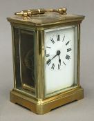 A late 19th/early 20th century brass cased carriage clock