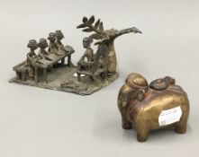 A 19th century brass inkpot in the form of an elephant and an Indian bronze group of school