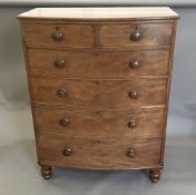A large Victorian mahogany bow front chest of drawers