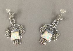 A pair of silver marcasite and opal earrings