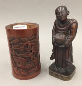 A 17th century Chinese carved bamboo figure of a Buddhist priest and a 19th century carved Chinese