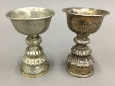 Two Indian white metal butter lamps