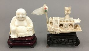 An early 20th century ivory carving of a Chinese junk on a wooden stand and an early 20th century