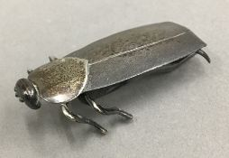 A small Japanese silver plated model of an insect