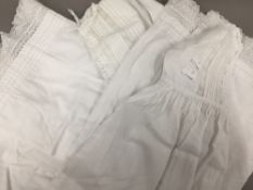 A quantity of vintage lace Christening gowns