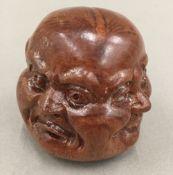 A wooden four faced Buddhas head