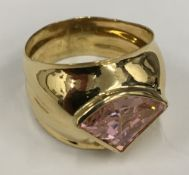 An 18 ct gold and pink topaz ring, stamped 750 (5.