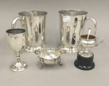 Two plated tankards, a small silver trophy cup, a small silver sauce boat, etc.