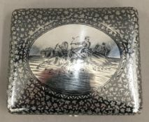 A Russian silver and niello cigarette case depicting two men on a troika driving through the snow,