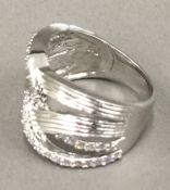 A silver and cubic zirconia crossover ring