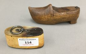 A 19th century horn snuff box and a treen snuff box formed as a clog