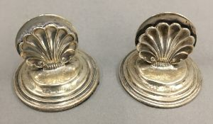 A pair of silver menu holders