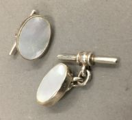 A pair of silver and mother-of-pearl cufflinks