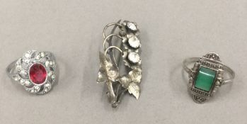 Two silver rings and a brooch