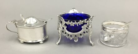 A small silver mustard pot with blue glass liner and a spoon Birmingham 1922,