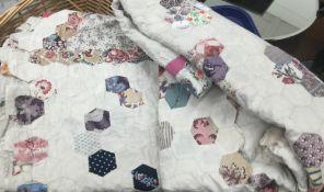 A vintage patchwork quilt, etc.
