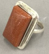 A silver goldstone ring